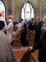Slovakian Norbertine Sisters (white veils), Sacred Heart Carmelite Sisters and some family members of the professurae during the Gospel reading